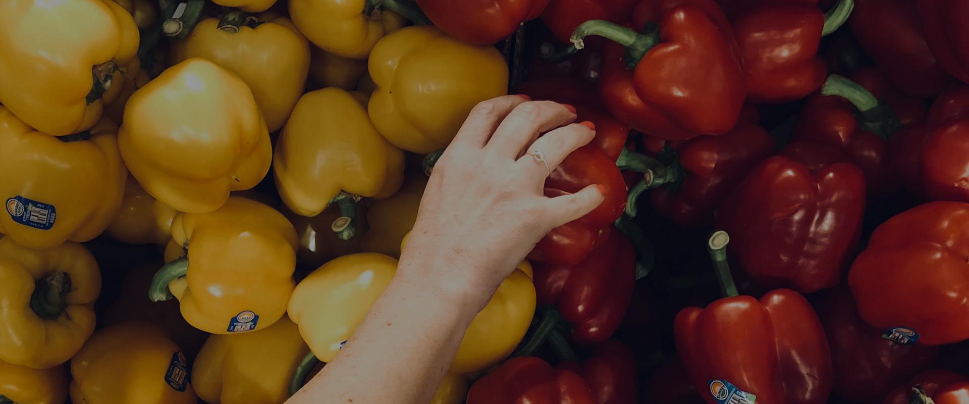 Hand grabbing groceries